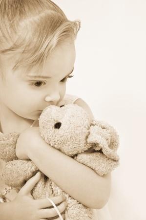 girl-cuddling-teddy