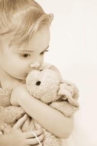 girl cuddling teddy